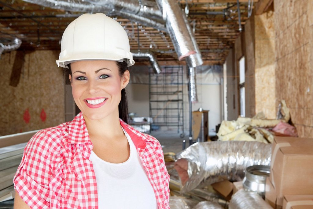 Stock Photo: 1654R-52236 Close_up portrait of smiling young woman contractor at construction site