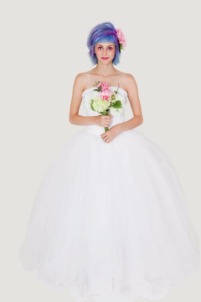 Stock Photo: 1654R-52669 Portrait of beautiful young woman in wedding outfit with dyed hair against gray background