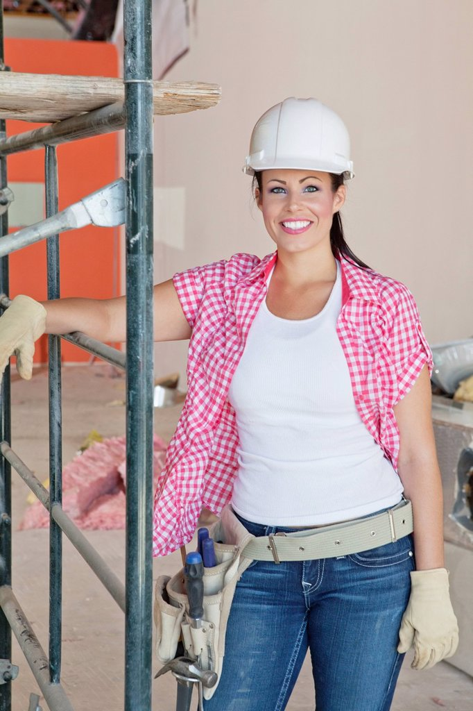 Stock Photo: 1654R-52727 Portrait of happy architect wearing hardhat standing at construction site