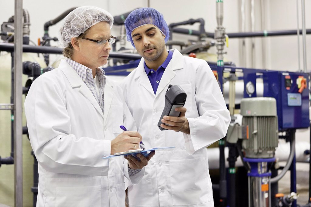 Stock Photo: 1654R-52923 Two men working in bottling factory