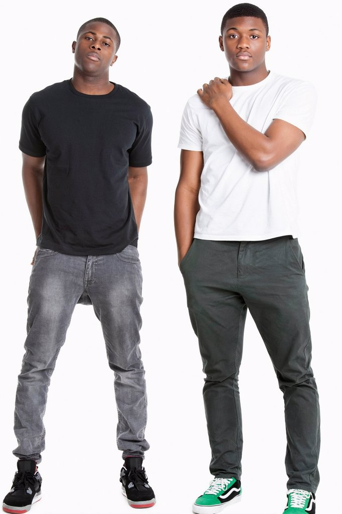 Stock Photo: 1654R-53037 Portrait of two young men in casuals over gray background