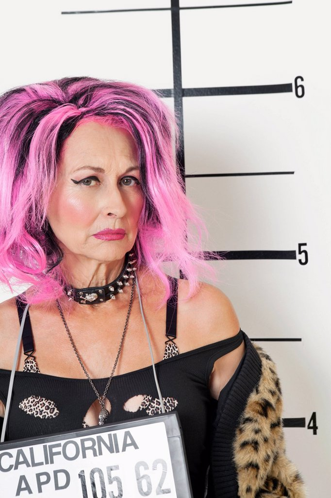 Stock Photo: 1654R-53220 Mug shot of senior punk woman