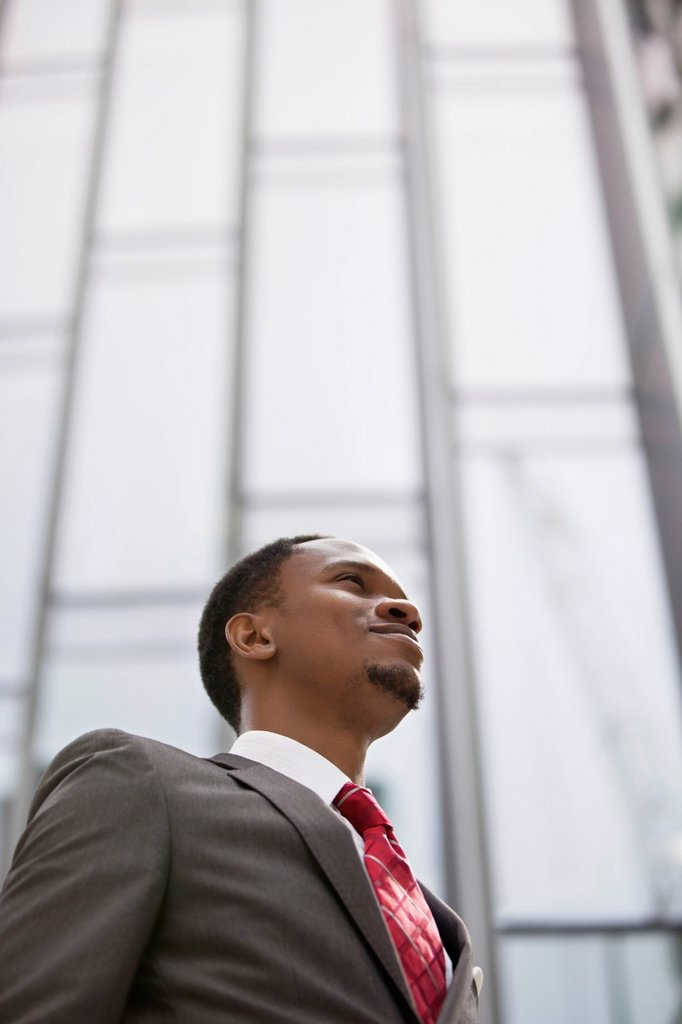 Confident African American businessman looking away : Stock Photo