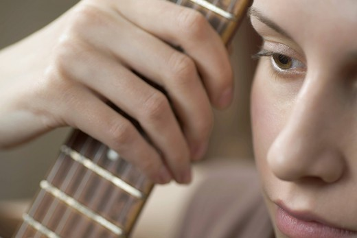 Cropped image of woman holding guitar : Stock Photo