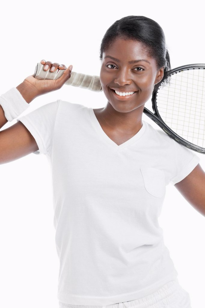 Stock Photo: 1654R-54626 Portrait of young female tennis player holding racket over white background