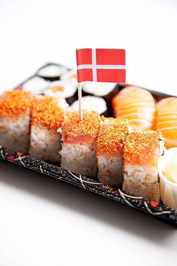 Stock Photo: 1654R-54661 Sushi food on tray with Danish flag against white background