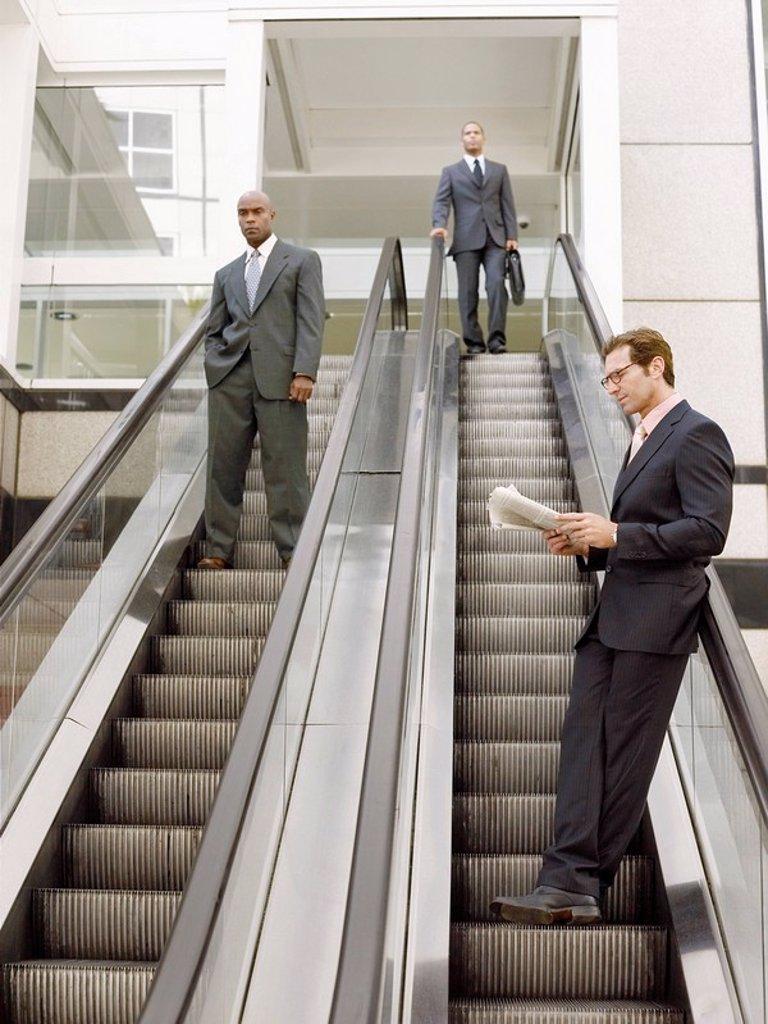 Stock Photo: 1654R-5573 Businessmen on escalators
