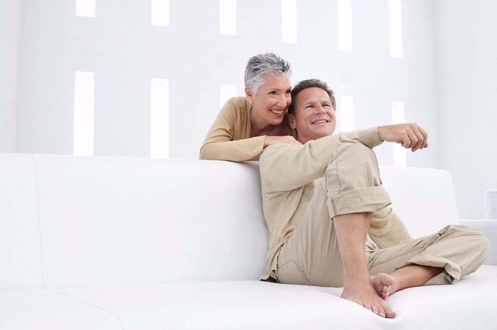 Stock Photo: 1654R-5814 Couple in living room smiling