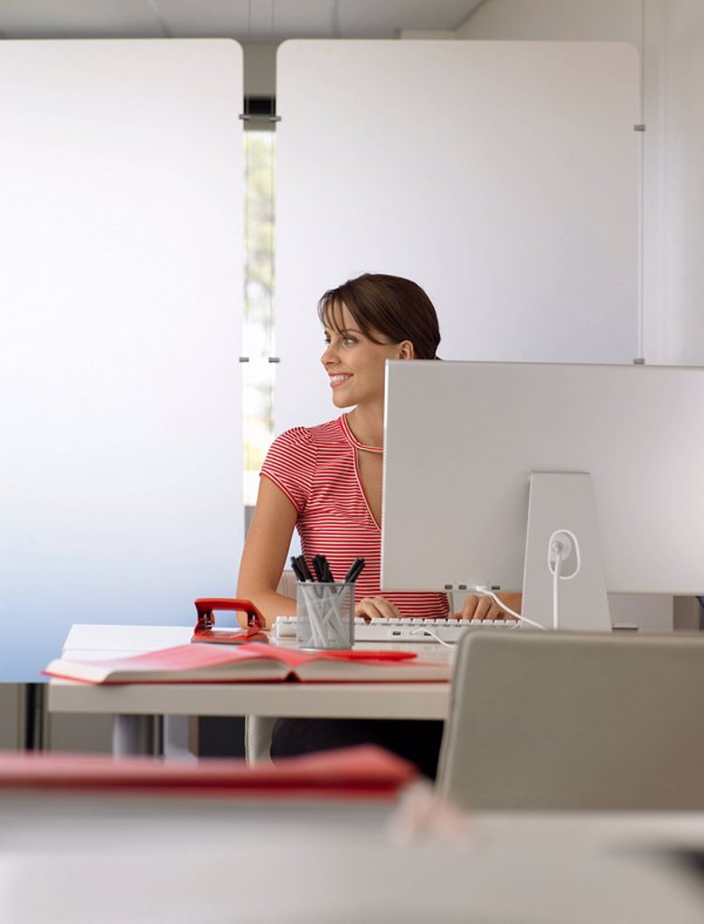Businesswoman at desk half length : Stock Photo