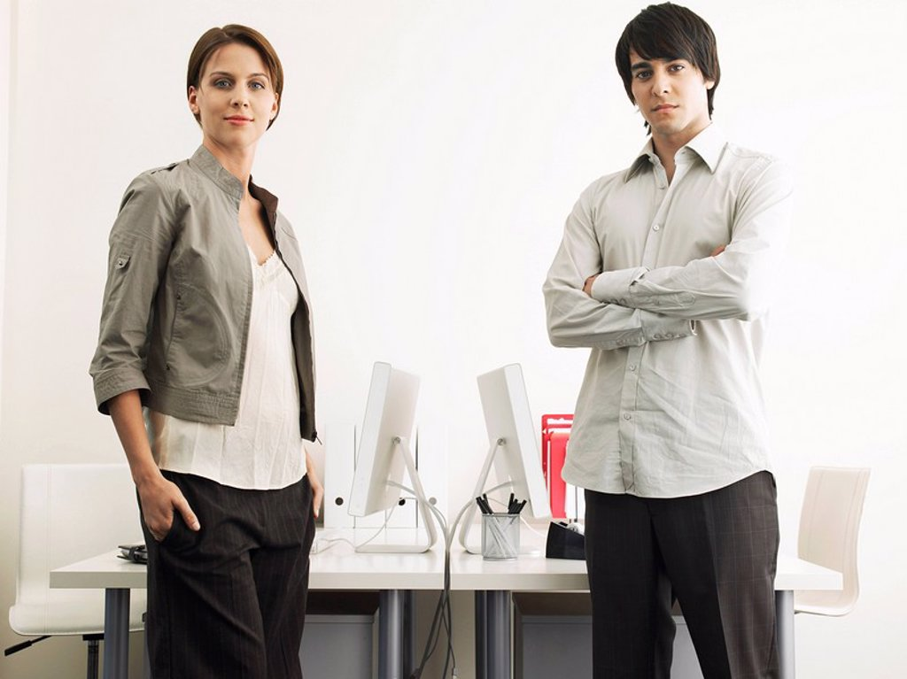 Business Man and Woman standing in office : Stock Photo