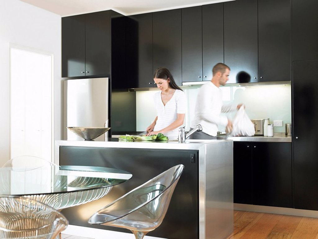 Couple in modern kitchen : Stock Photo
