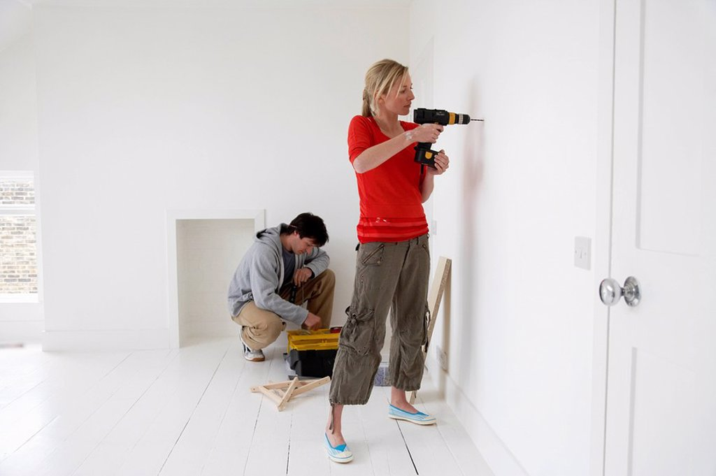 Stock Photo: 1654R-6045 Couple working on their new home