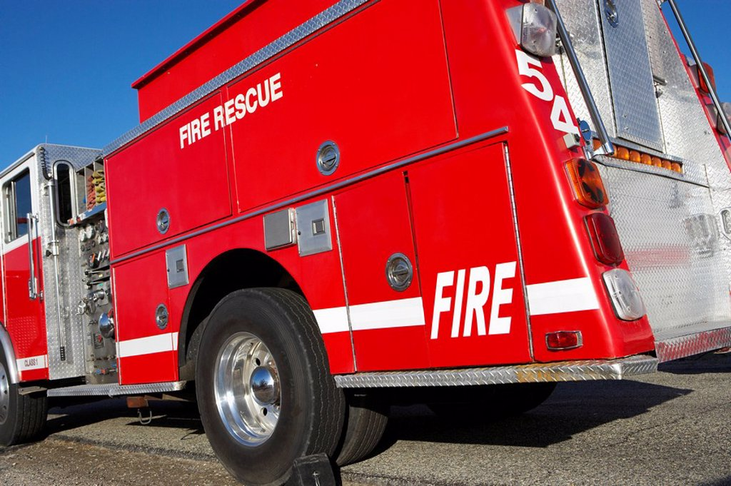 Fire rescue truck parked on roadside : Stock Photo