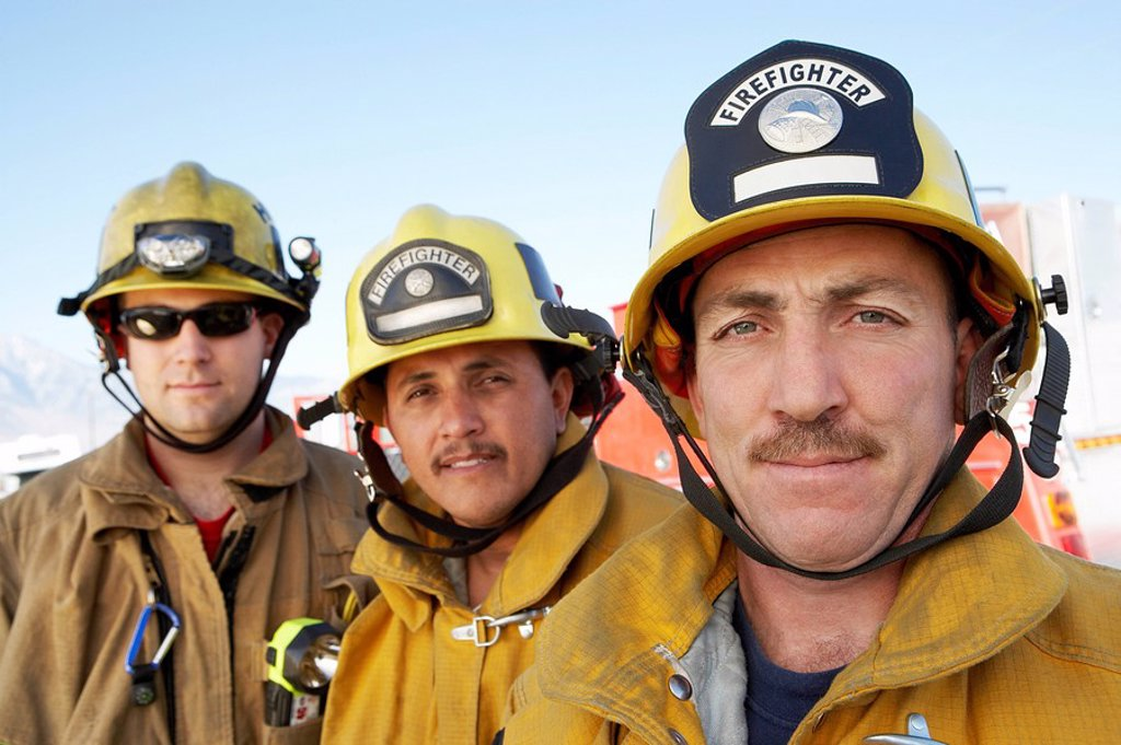 Three fire fighters portrait : Stock Photo