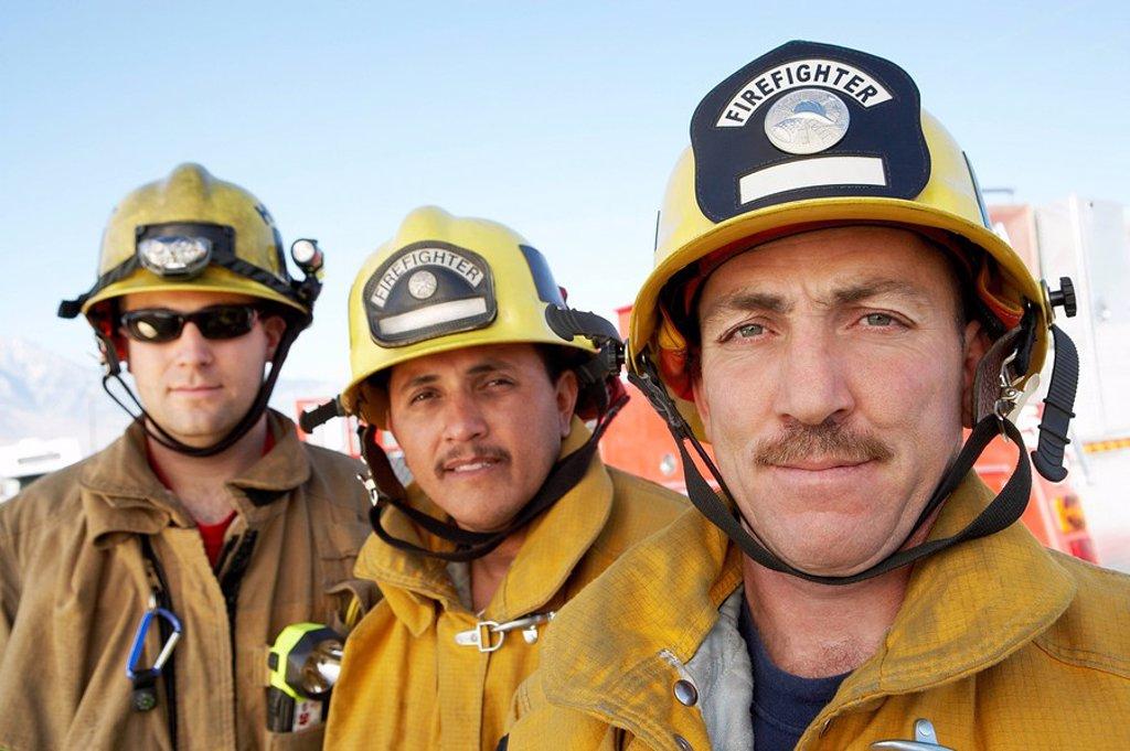 Stock Photo: 1654R-6246 Three fire fighters portrait