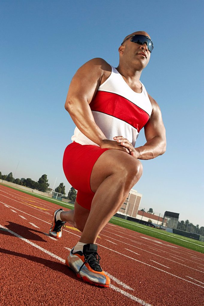 Stock Photo: 1654R-6465 Track Athlete Warming Up