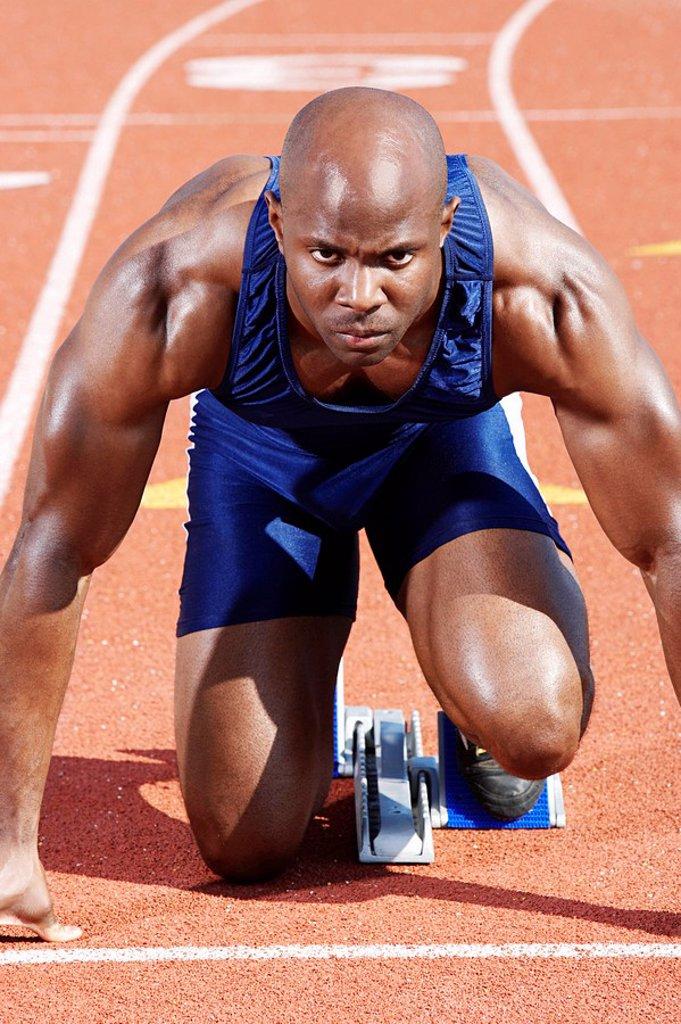 Track Athlete on starting block : Stock Photo