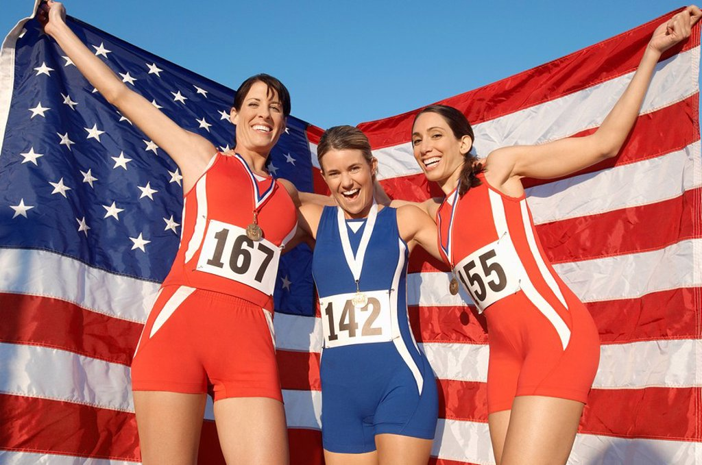 Stock Photo: 1654R-6490 Athletes celebrating with medals and American flag