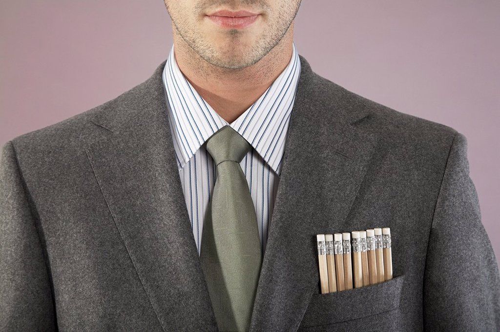 Stock Photo: 1654R-6766 Young businessman with pencils in pocket close_up portrait