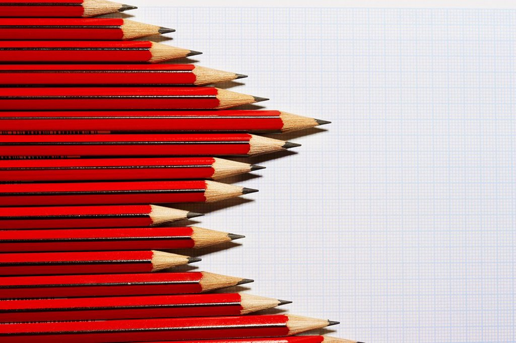 Stock Photo: 1654R-6913 Pencils forming bar graph pattern on graph paper view from above