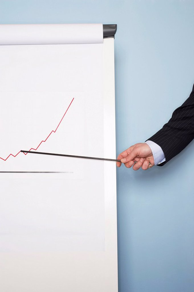 Businessman pointing at graph on easel close_up of hand : Stock Photo