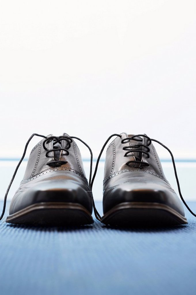 Stock Photo: 1654R-6956 Pair of wing_tip shoes front view