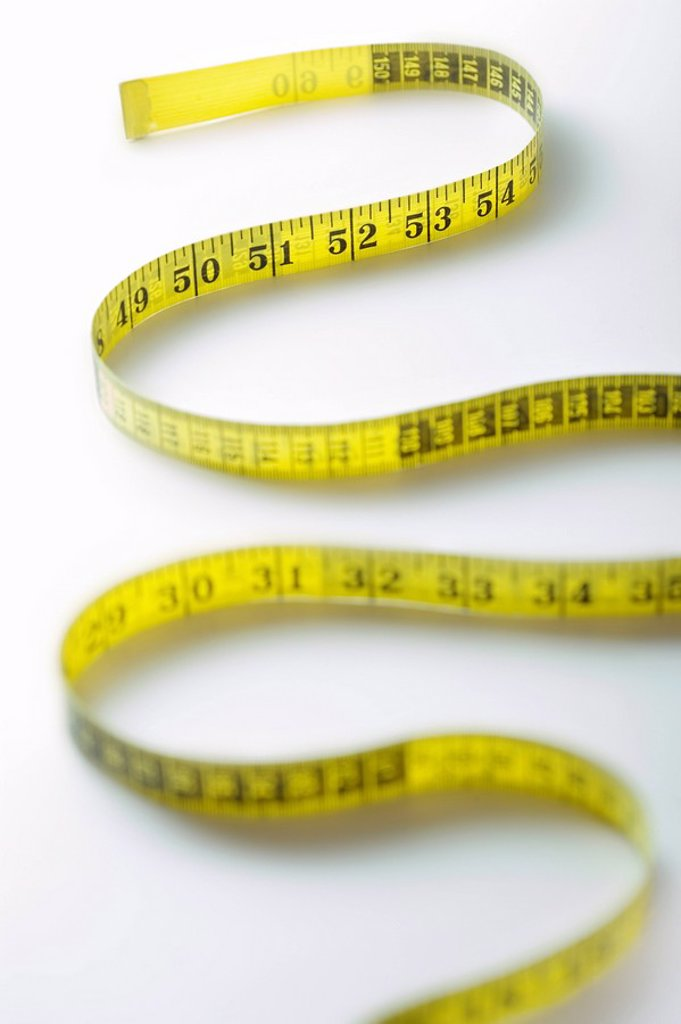 Winding strip of measuring tape close_up : Stock Photo