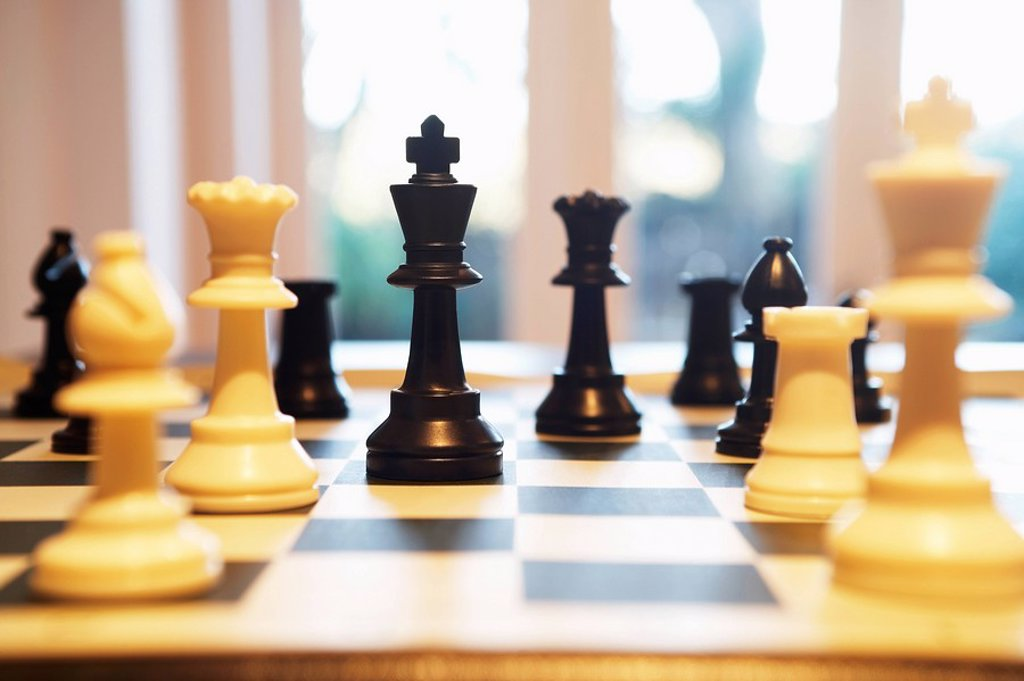 Stock Photo: 1654R-7049 Chess pieces standing on chess board