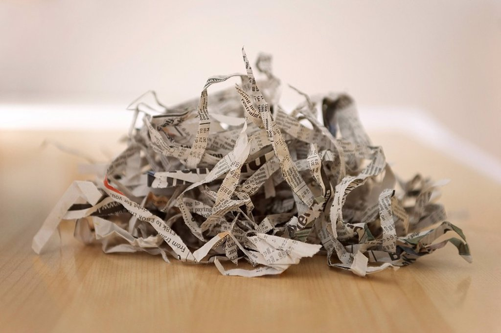 Stock Photo: 1654R-7062 Pile of shredded newspaper close_up