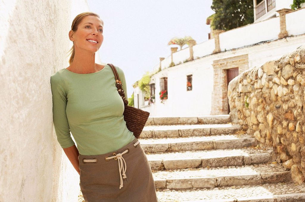 Tourist on Steps in Granada Spain front view : Stock Photo