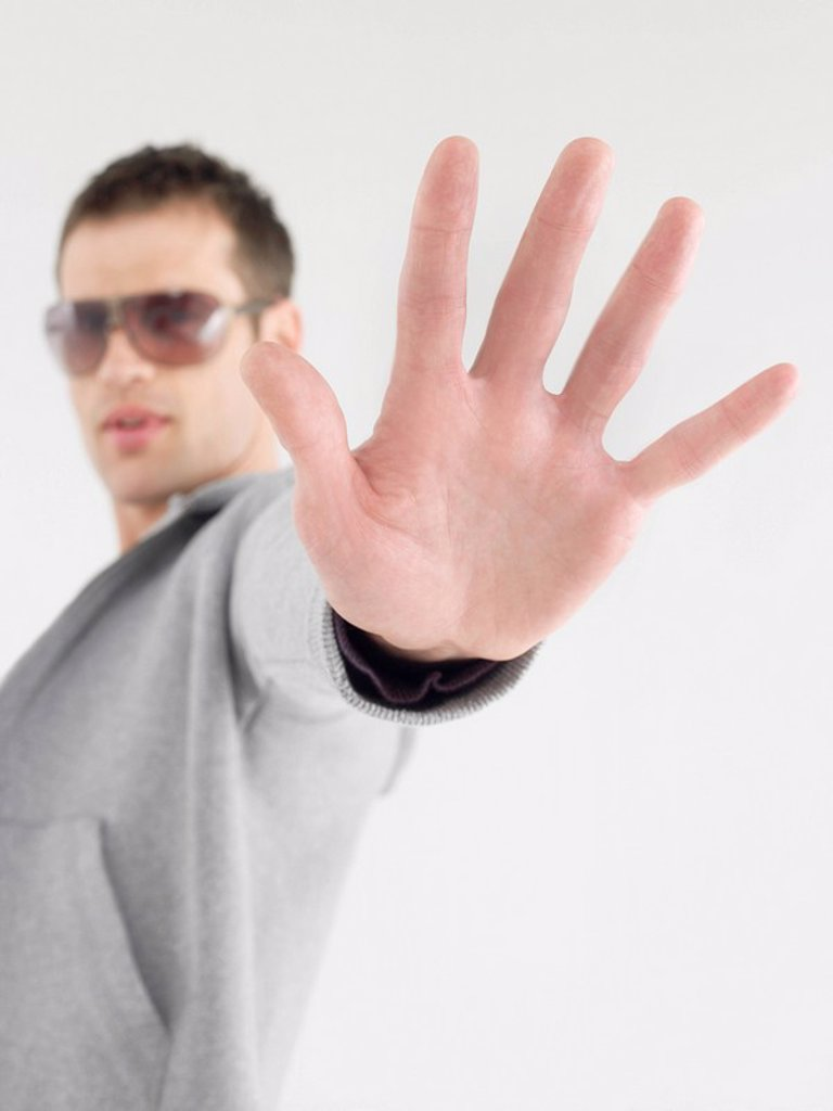 Man in sunglasses viewed past extended hand : Stock Photo