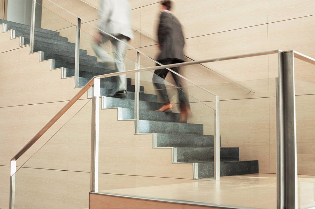 Stock Photo: 1654R-7562 Businessmen Climbing Stairs