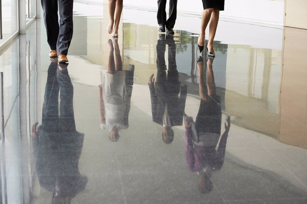 Stock Photo: 1654R-7598 Businesspeople Walking on corridor low section