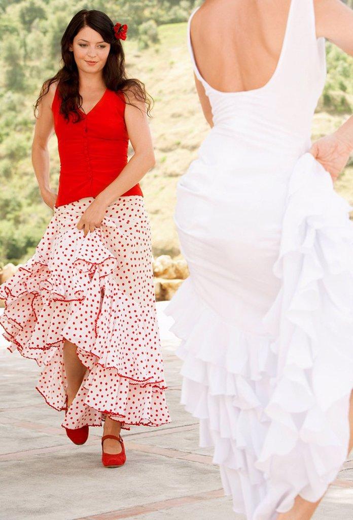 Two women flamenco dancing outdoors. : Stock Photo