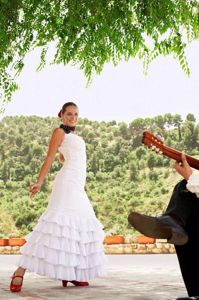 Stock Photo: 1654R-7622 Woman flamenco dancing with man playing guitar.