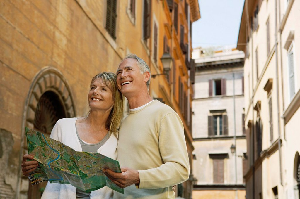 Couple on street with map in Rome Italy low angle view : Stock Photo
