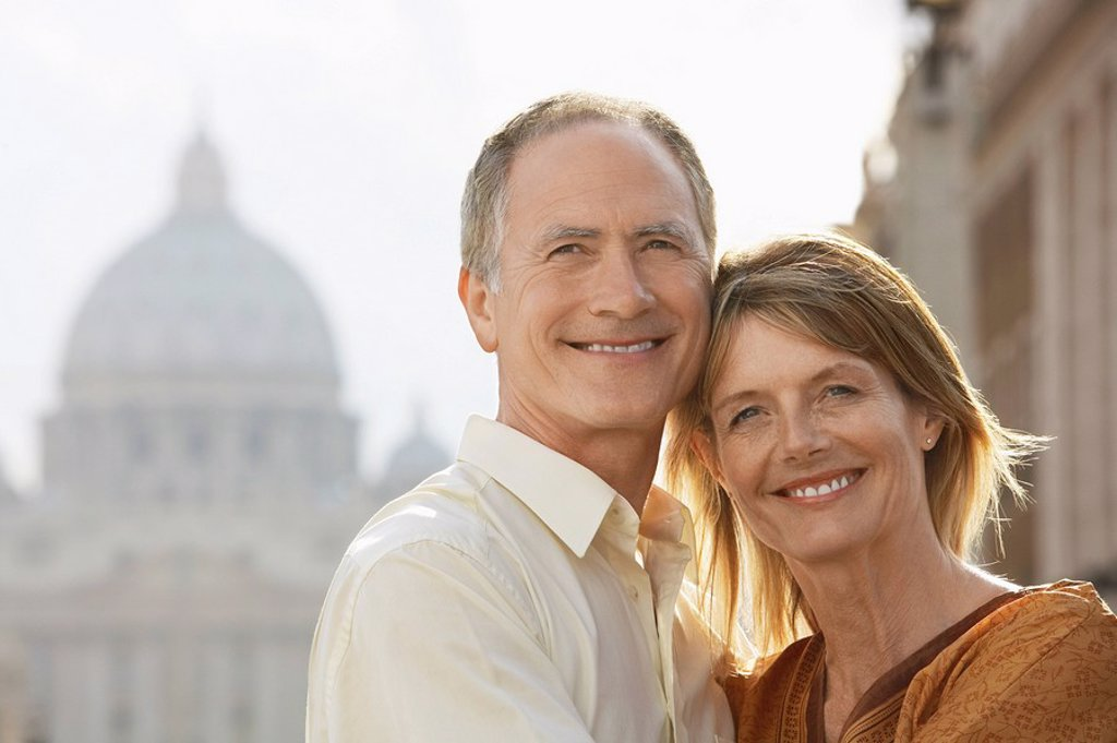 Middle_aged couple hugging in Rome Italy front view portrait : Stock Photo