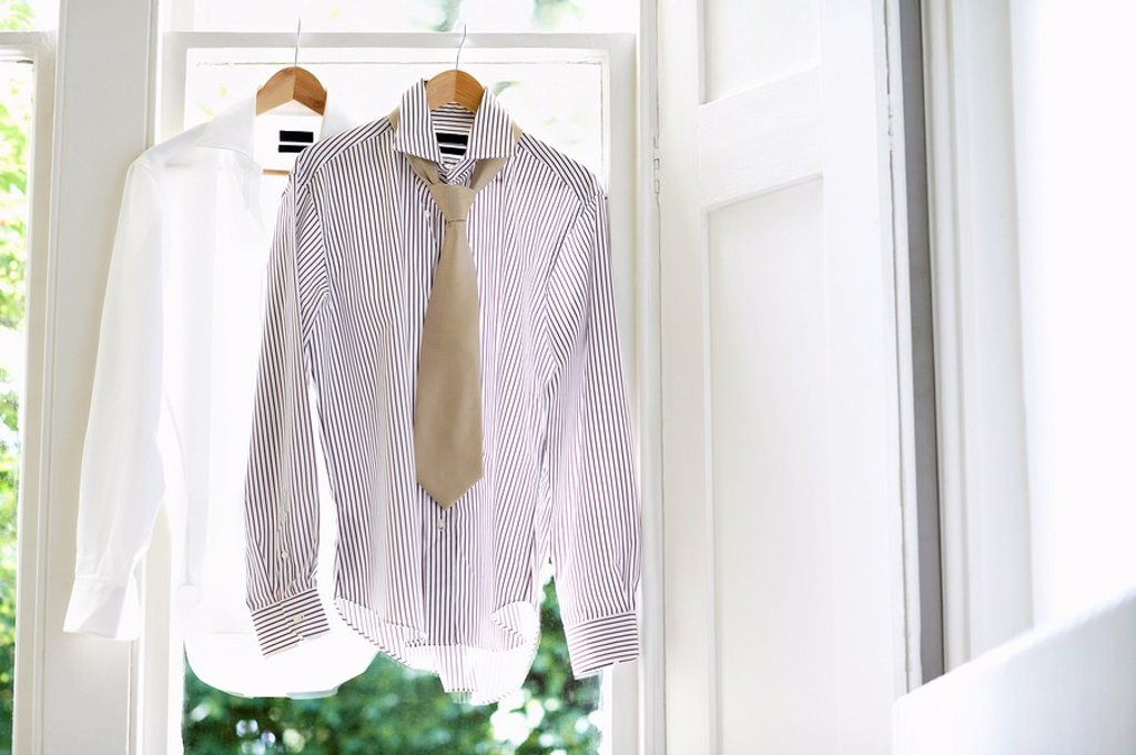 Two Dress Shirts on Hangers in domestic window : Stock Photo