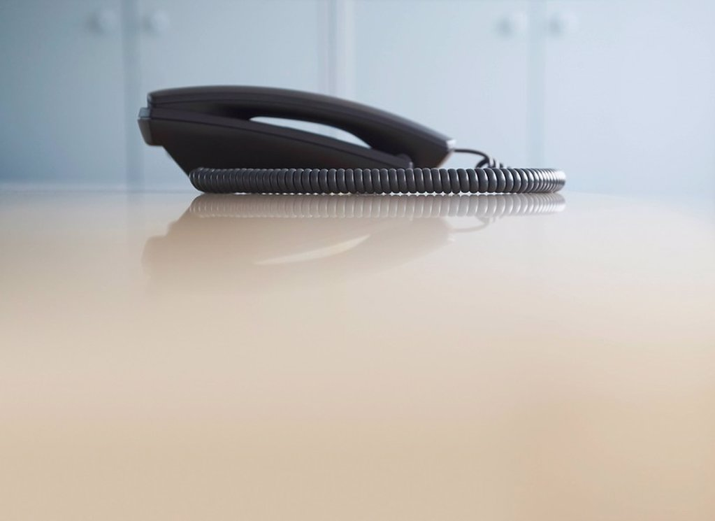 Telephone on desk side view : Stock Photo
