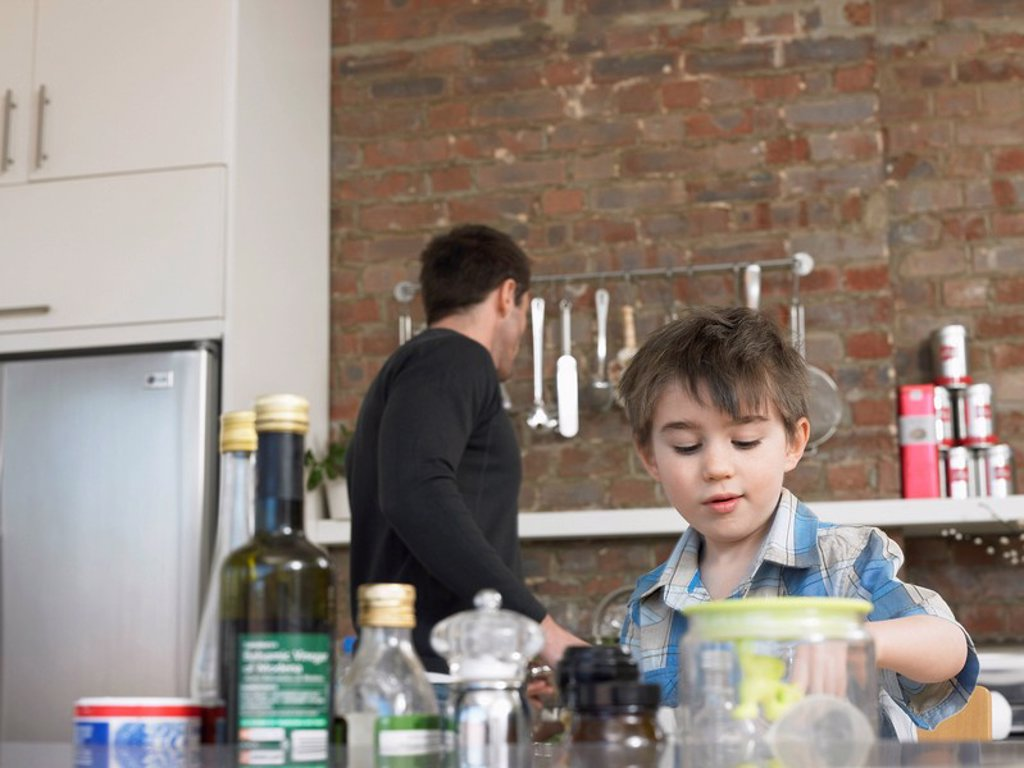 Stock Photo: 1654R-8121 Father and son 3_4 in kitchen