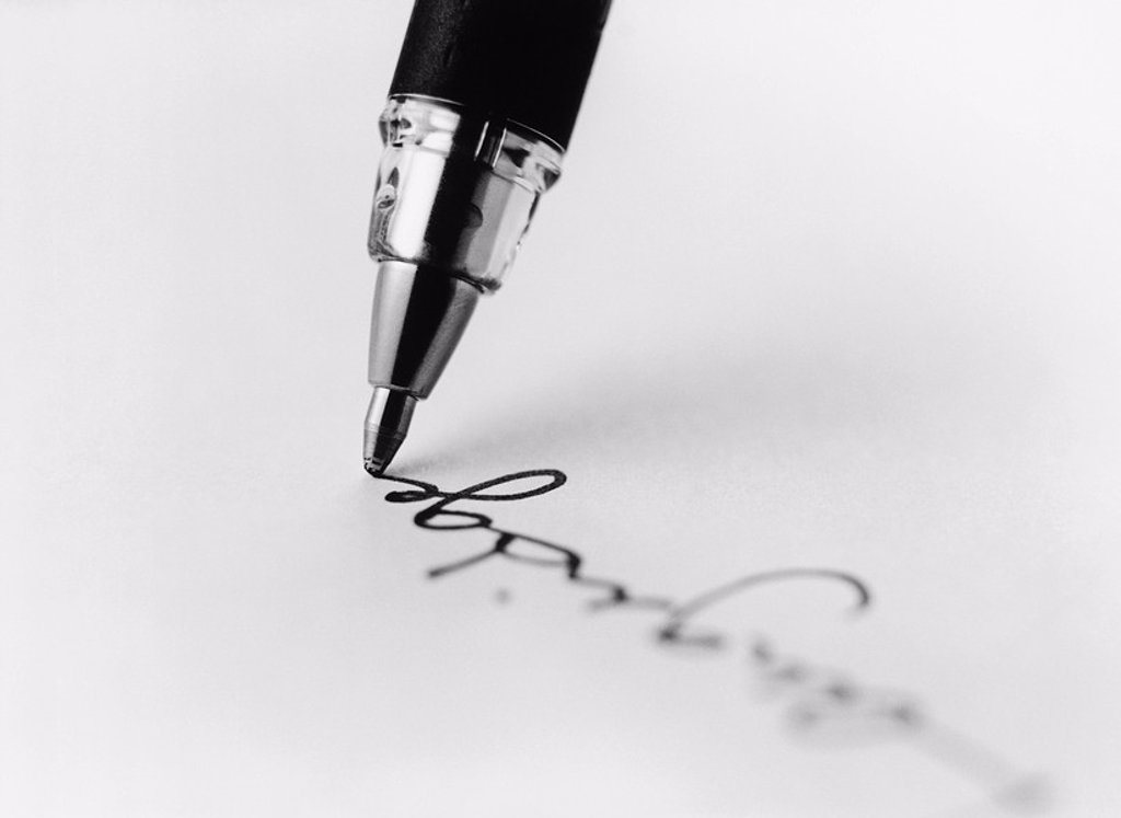 Tip of pen writing on paper b&w close_up : Stock Photo