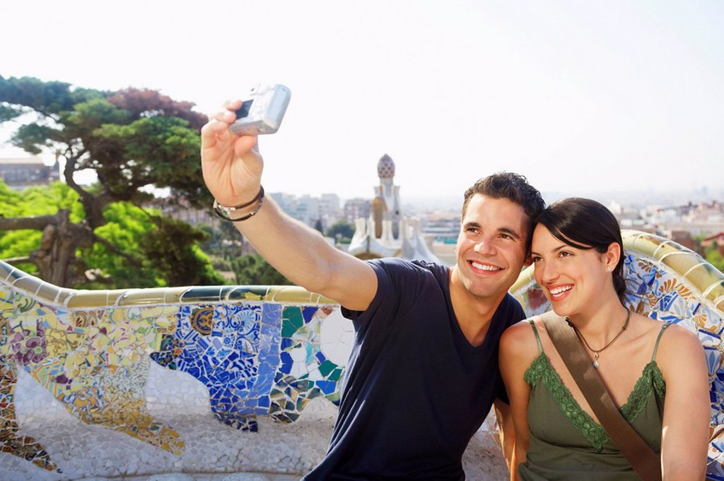 Smiling couple taking photo of themselves portrait : Stock Photo