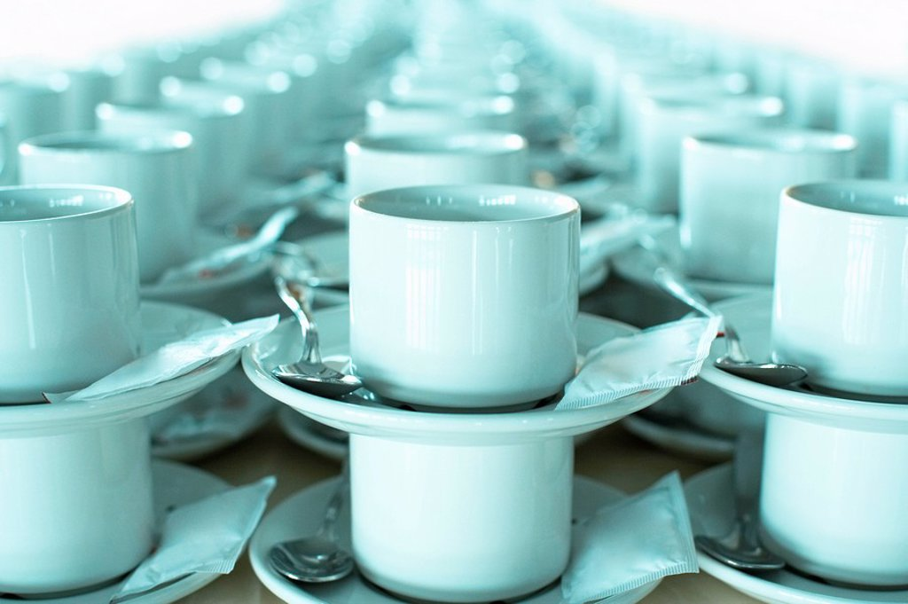 Rows of stacked teacups and saucers close_up. : Stock Photo