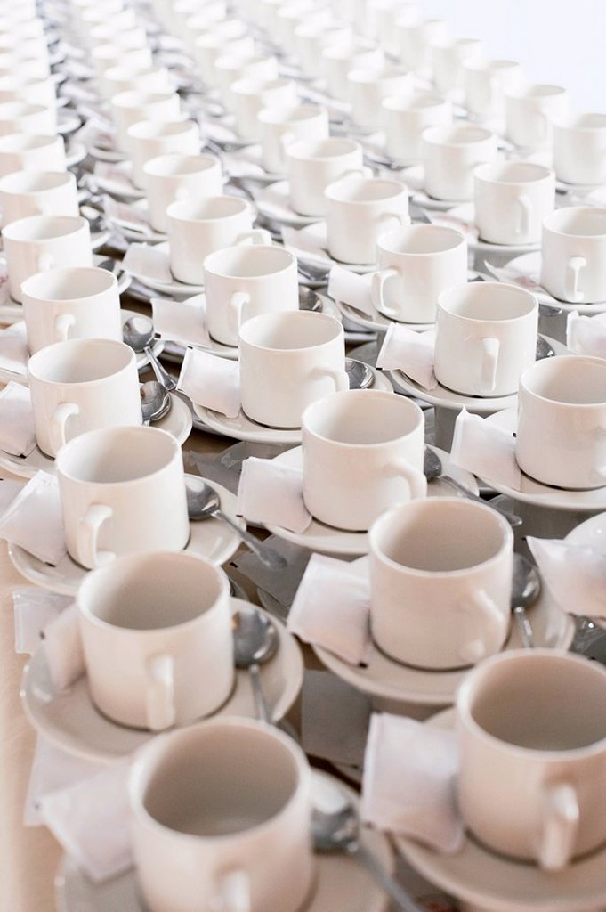 Rows of stacked teacups and saucers elevated view. : Stock Photo