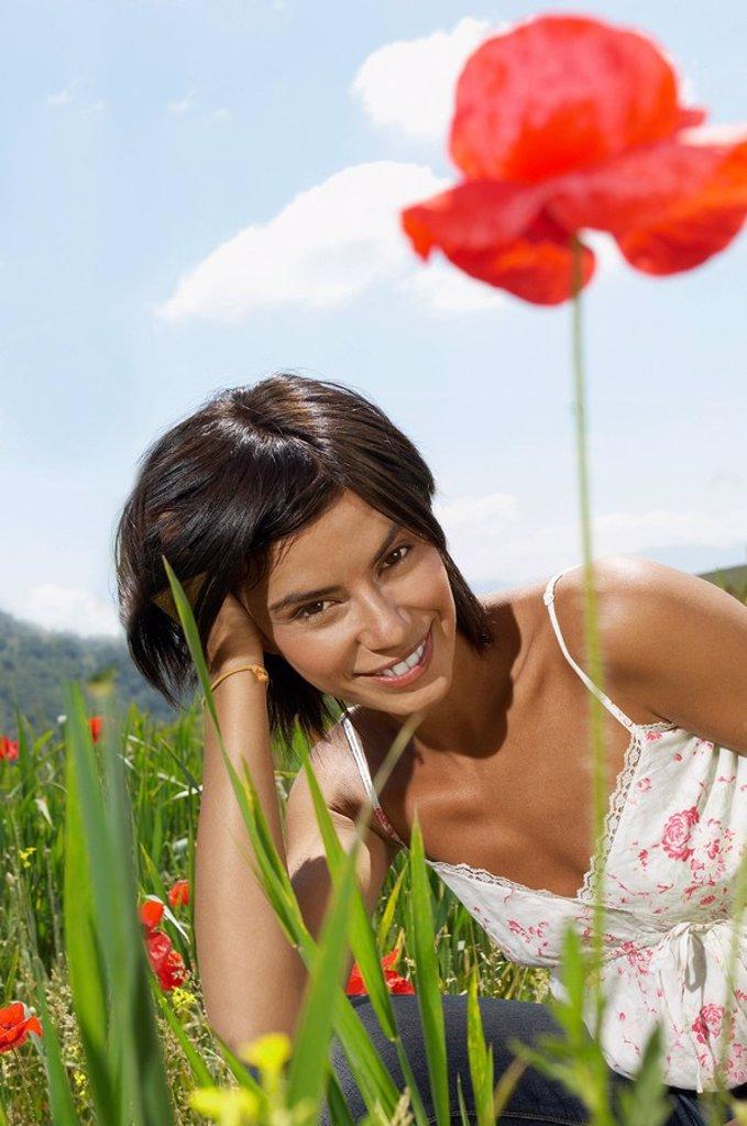 Woman Lying in flowery Meadow portrait : Stock Photo