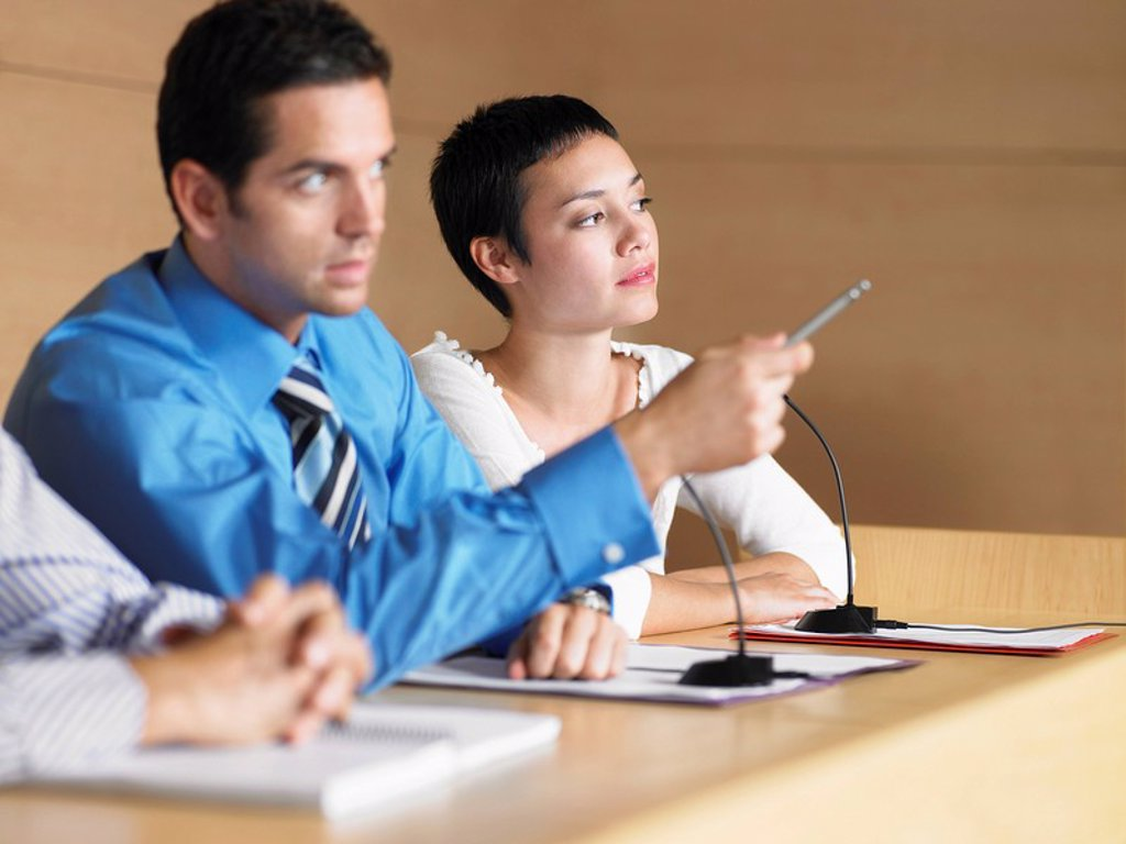 Three businesspeople at Panel Presentation : Stock Photo
