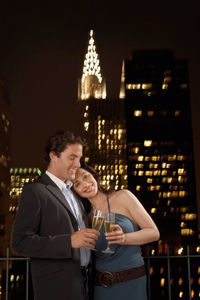 Couple Toasting with Champagne against New York Night Skyline : Stock Photo