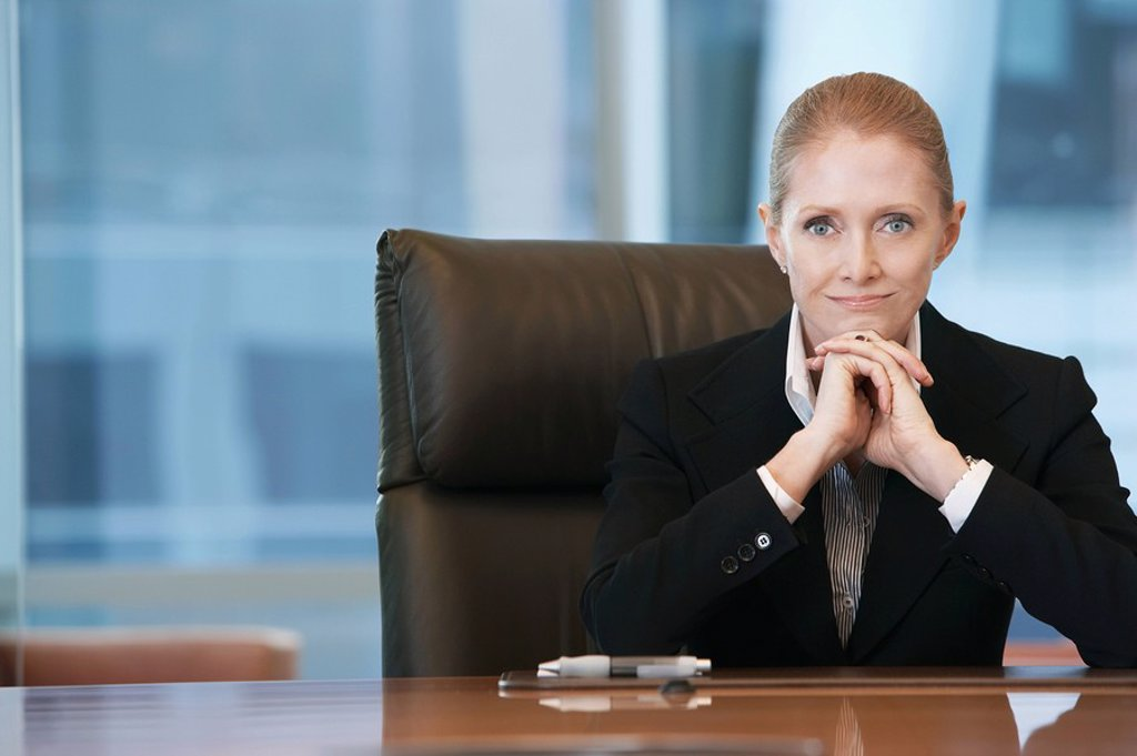 Stock Photo: 1654R-9241 Businesswoman sitting at conference table portrait