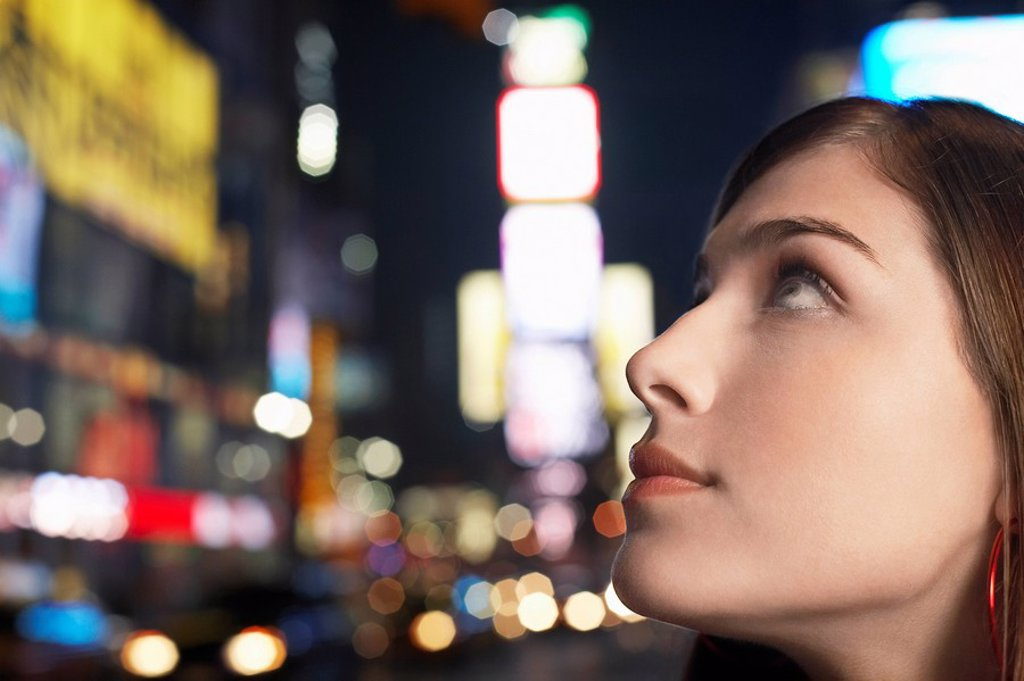 Young Woman on Nighttimes City Street close up profile : Stock Photo
