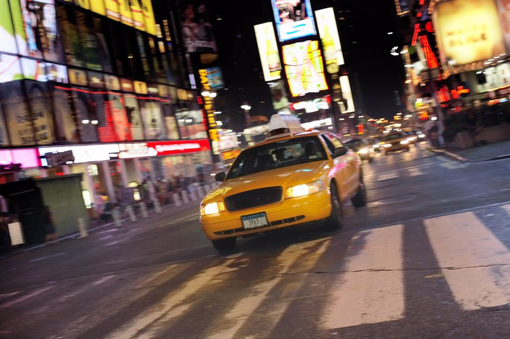 Yellow Taxi on City Street at Night : Stock Photo